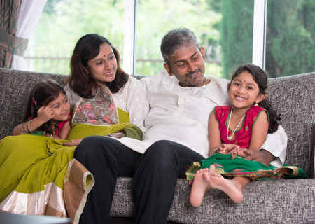 indian woman traditional: indian family in living room
