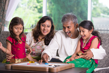 indian happy family: indian family in living room