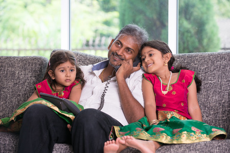indian father with his daughter on phone conversation lifestype photo photo