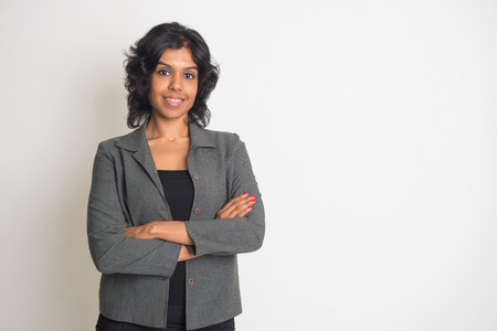 plain background: indian business woman smiling with plain background