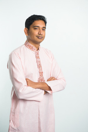 kurta: traditional indian male  portrait with plain background and copyspace