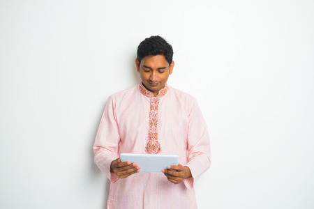dhoti: traditional indian male with tablet and plenty of copyspace   Stock Photo