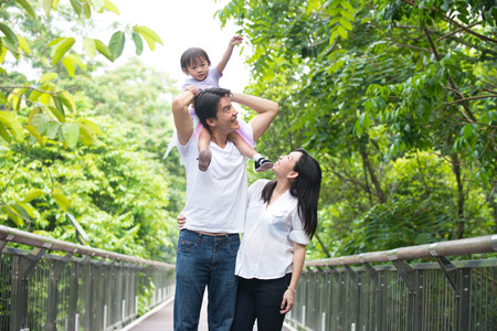 healthy asian family: asian pregnant mother and family outdoor photo
