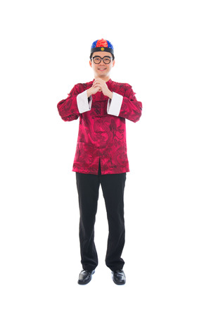 gong xi fa cai: asian male with traditional chinese new year greeting gong xi fa cai