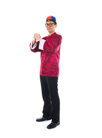 asian male with traditional chinese new year greeting gong xi fa cai photo