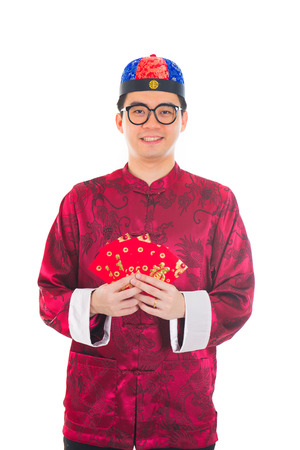 Asian Chinese man showing many red packets photo