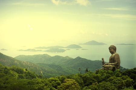 Hong Kong, Lantau Island Giant Buddha of Po Lin Monastery far away view during sunrise