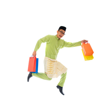 malay male with shopping bags during festival season   photo