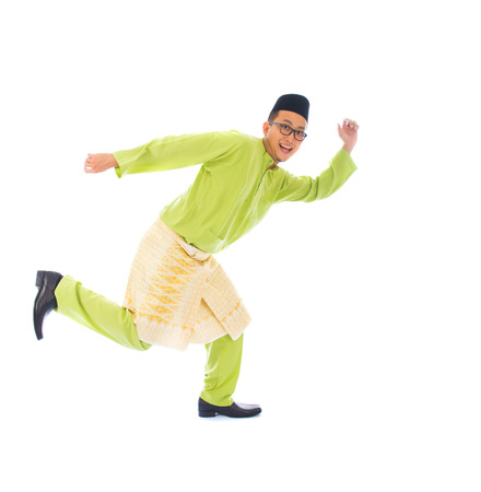 hari: malay male jumping celebrating hari raya eid fitr after ramadan