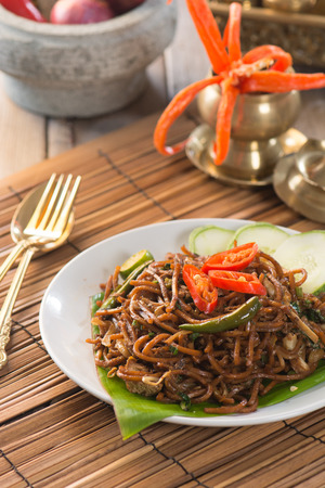 oriental cuisine: asian spicy fried noodle