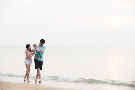 Portrait of an asian family on beach photo