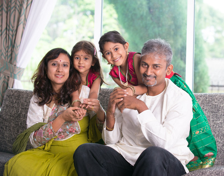 quality home: happy indian family enjoying quality time at home indoor