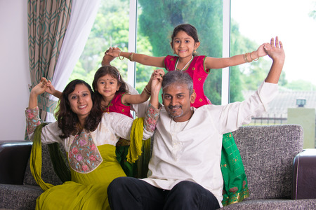 indian woman traditional: happy indian family enjoying quality time at home indoor