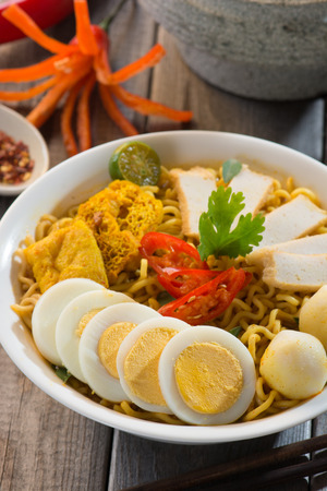 Hot and spicy Singapore Curry Noodle   photo