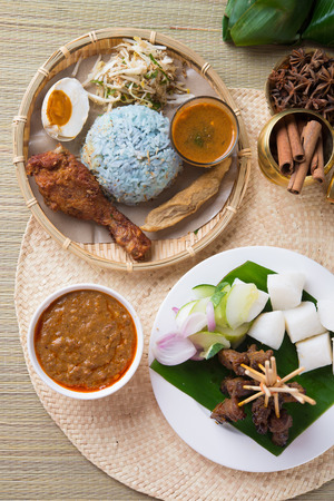 ramadhan: Traditional Malaysian food. Nasi kerabu is a type of nasi ulam, popular Malay rice dish. Blue color of rice resulting from the petals of butterfly-pea flowers. Asian cuisine.   Stock Photo