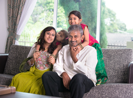 happy indian family enjoying quality time at home indoor   photo