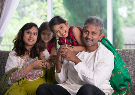 indian people: happy indian family enjoying quality time at home indoor