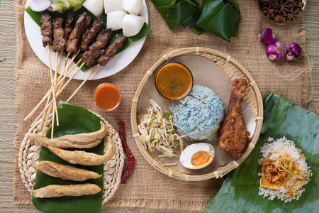 malaya: Traditional Malaysian food. Nasi kerabu is a type of nasi ulam, popular Malay rice dish. Blue color of rice resulting from the petals of butterfly-pea flowers. Asian cuisine.   Stock Photo
