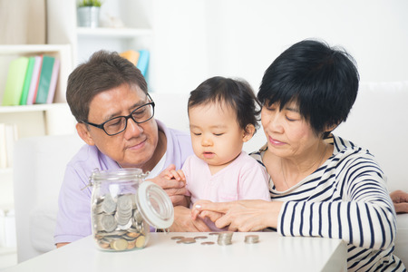 asian grand parents with grand daugther education saving concepts photo