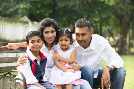 south park: indian family sitting on the bench in the park