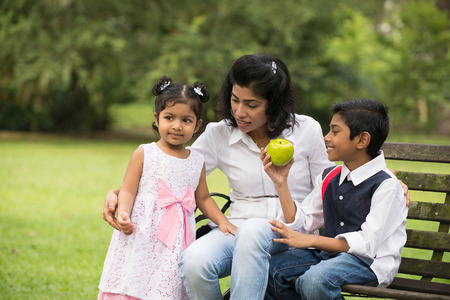 outdoor eating: indian family outdoor eating healthy photo   Stock Photo