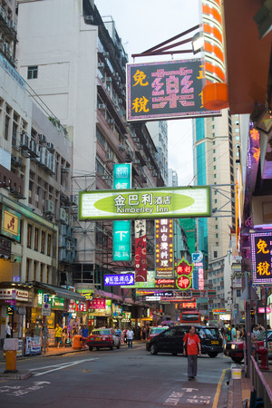 sq: HONG KONG, CHINA - July 1st: Street view at night on July 1st, 2014 in Hong Kong, China. With 7M population and land mass of 1104 sq km, it is one of the most dense areas in the world.