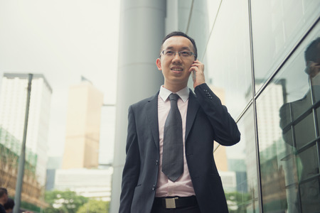 hong kong businessman in busy central district, light vintage blue tone applied Stock fotó