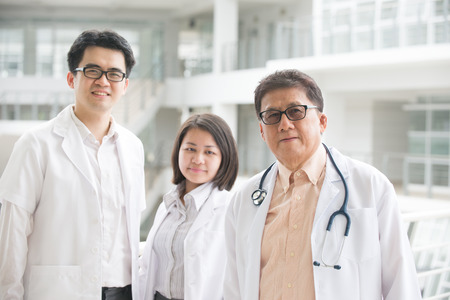 asian medical: Asian medical team of doctors standing inside hospital building Stock Photo