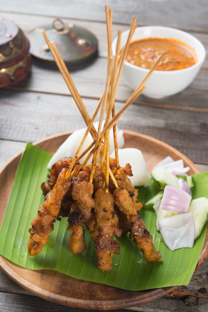 malay food: delicious malaysian satay with curry sauce