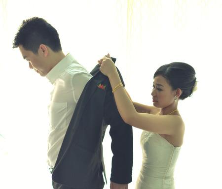 chinese wedding ceremony of taking off coat , light vintage\ tone