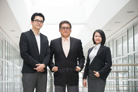 servicing: asian business team Stock Photo