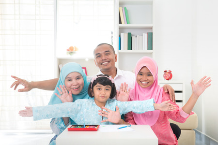 indonesian woman: malay family learning together with lifestyle background