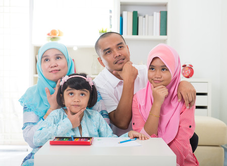 malay family learning together with lifestyle background photo
