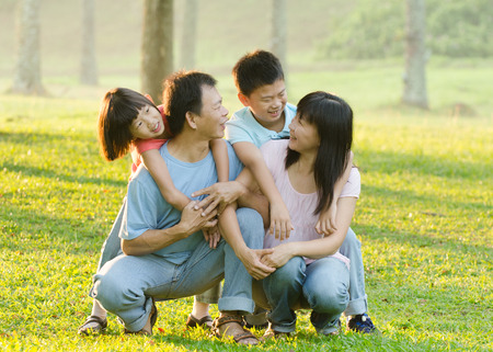 asian family enjoying outdoor at the park photo