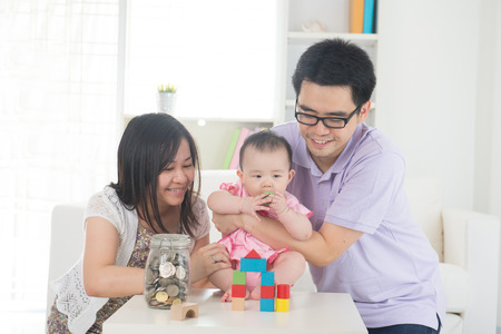 malaysian people: asian family money saving concept lifestyle photo Stock Photo