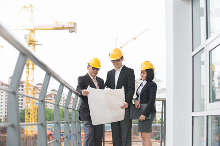 asian architect team in discussion on worksite Stock Photo