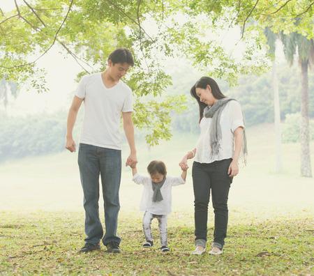 asian family enjoying outdoor park , vintage tone Stock Photo