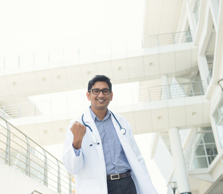 asian medical: indian male doctor celebrating success , slight vintage tone Stock Photo