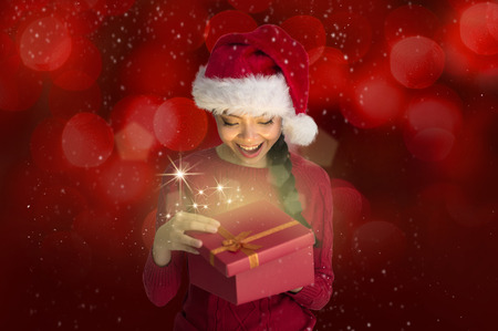 malaysian people: asian girl opening christmas gift surprise look