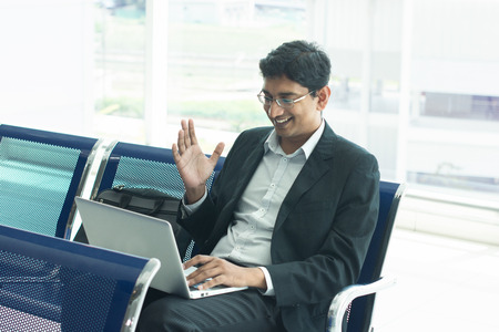 airport lounge: indian male business man working from airport terminal Stock Photo