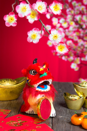culture decoration celebration: Chinese New Year Decoration plum blossom and gold bullion symbol of luck Stock Photo
