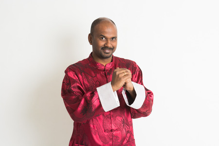 indian male with chinese new year clothes photo