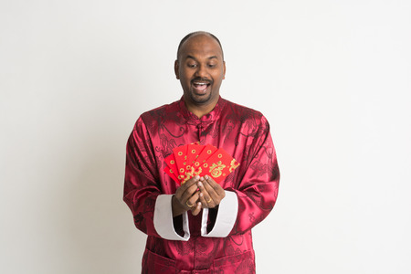 indian male with chinese new year clothes and ang pao photo