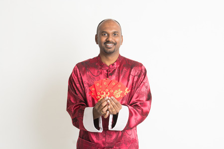 ang: indian male with chinese new year clothes and ang pao