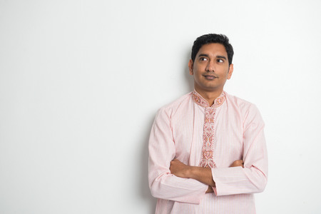 kurta: traditional indian male portrait with plain background and copyspace Stock Photo