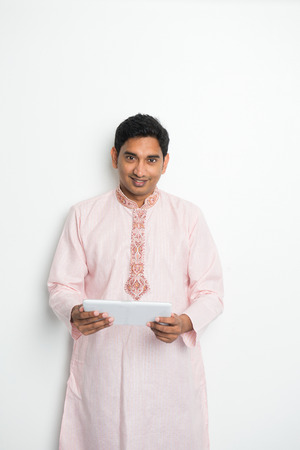 kurta: traditional indian male with tablet and plenty of copyspace