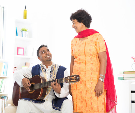 Happy mature Indian woman with her adult son photo