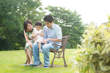male bonding: Happy Asian Family enjoying their time in the park
