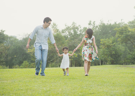 domestic garden: Happy Asian Family enjoying family time together in the park