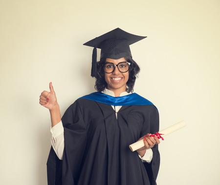 academic robe: indian female student graduating in vintage tone Stock Photo